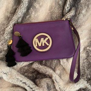 Purple leather Michael Kors wristlet